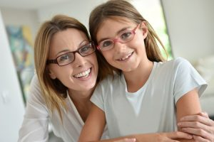 50356402 - portrait of mother and daughter with eyeglasses